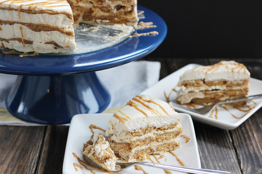 Nutter Butter Icebox Cake - An icebox cake recipe made with Nutter Butter cookies, creamy peanut butter sauce and peanut butter whipped cream. So rich! | www.worthwhisking.com