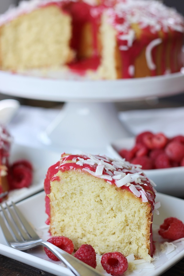 Raspberry Glazed Coconut Chiffon Cake - This coconut chiffon cake is light and airy, but oh so decadent! Raspberry glaze provides the perfect complement! | www.worthwhisking.com