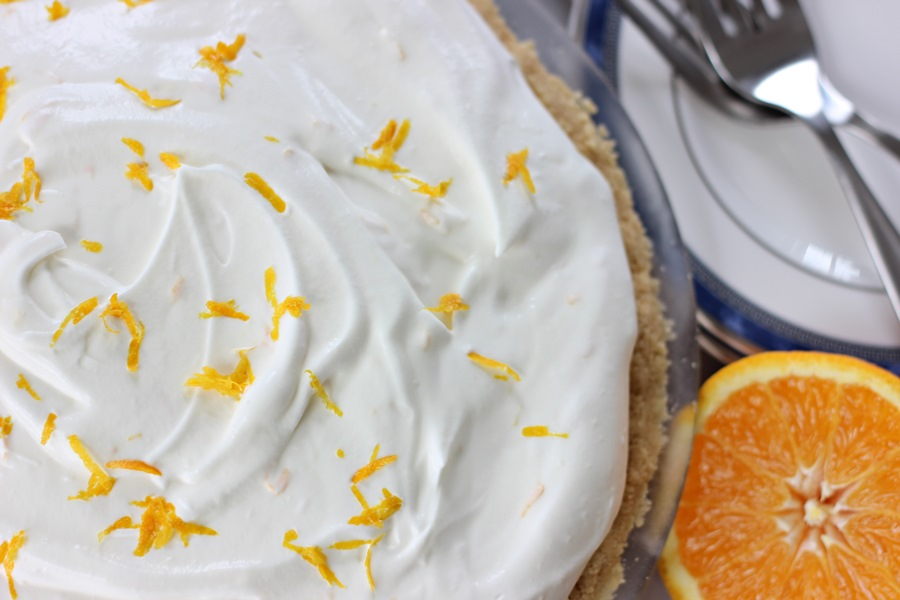Orange Vanilla Ice Cream Pie – A light and creamy orange vanilla ice cream pie recipe reminiscent of the classic orange Creamsicle frozen treat! | www.worthwhisking.com
