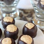 Crispy Buckeyes – Decadent peanut butter confections studded with crispy rice cereal and coated in semisweet chocolate. A classic holiday treat! | www.worthwhisking.com