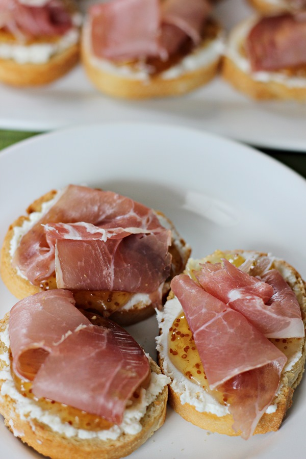 Goat Cheese Fig Prosciutto Crostini – An elegant and delicious, yet easy, appetizer that is just as appropriate for watching the big game as it is for a cocktail party. | www.worthwhisking.com