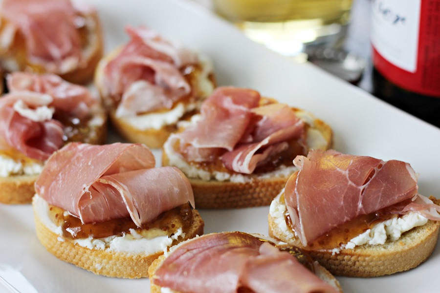 Goat cheese fig prosciutto crostini worth whisking for Canape plural