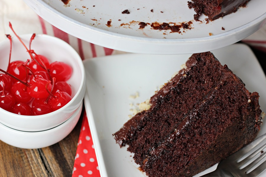 Double Cherry Chocolate Cake – A delectable chocolate cake with subtle cherry flavors topped by a creamy cherry-studded fudge frosting. | www.worthwhisking.com