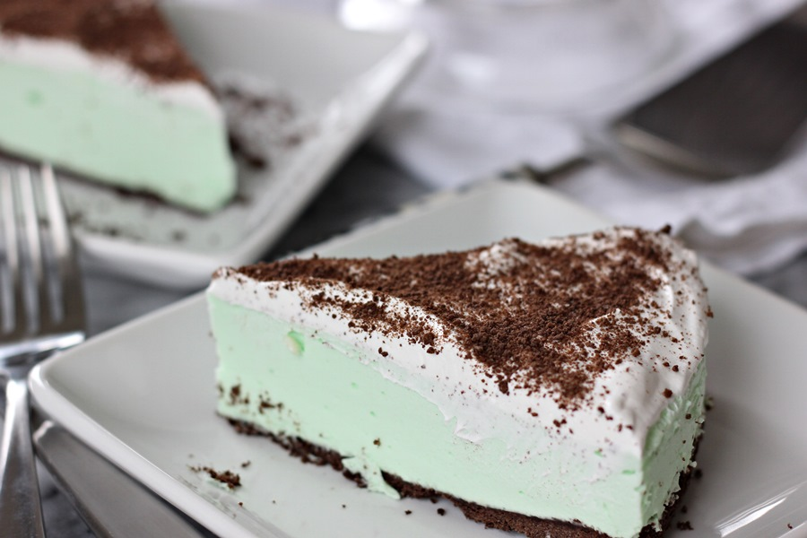 Grasshopper Torte – Whipped topping spread over a light, minty crème de menthe filling on a chocolaty graham cracker crust is a great holiday or anytime dessert! | www.worthwhisking.com