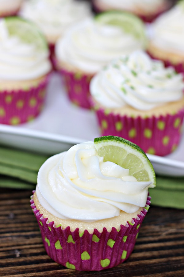Margarita Cupcakes – All the flavors of your favorite cocktail in dessert form! Smooth lime cream cheese frosting swirled atop tequila-spiked cake. | www.worthwhisking.com