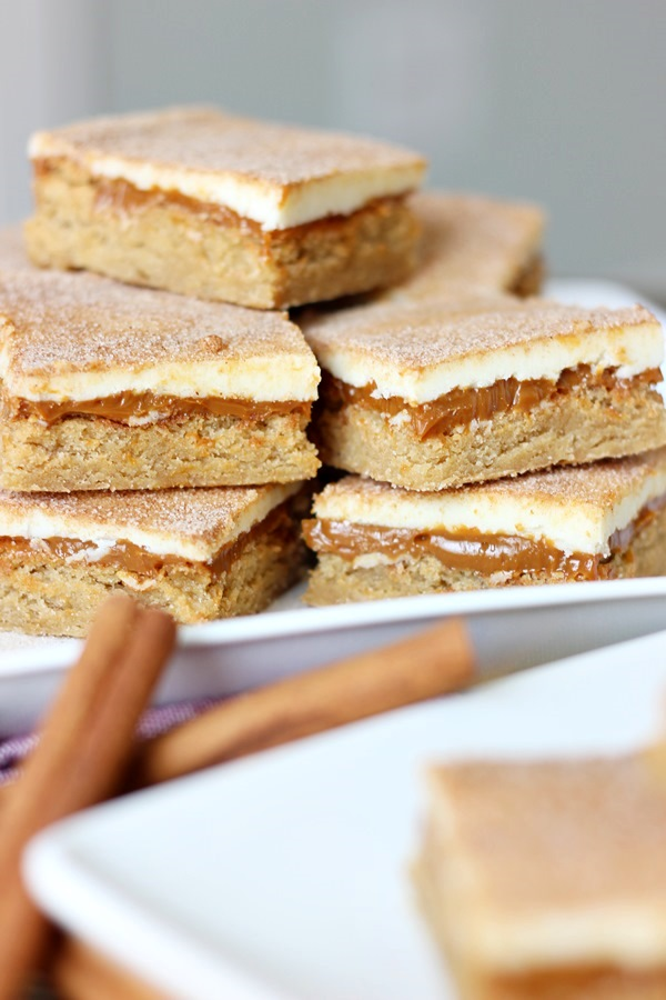 Dulce de Leche Bar Cookies – Think snickerdoodle cookies topped with layers of creamy caramel and white chocolate.  Simply amazing! | www.worthwhisking.com