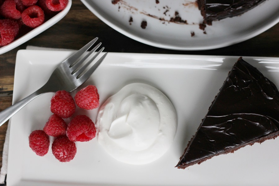 Flourless Chocolate Cake – A deceptively easy sinful, rich, dense chocolate cake perfect for any occasion.  Made with only six ingredients! | www.worthwhisking.com
